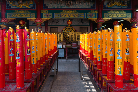 metropolis image: BANGKOK, THAILAND - 8 FEB 2016: Giant Red and Gold Candles Lighted on an Altar at Li Thi Miew Shrine chinese temple