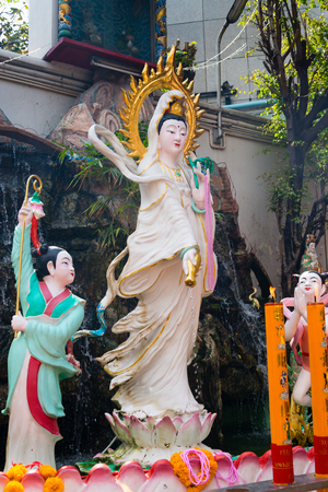 goddess of mercy: BANGKOK, THAILAND - 8 FEB 2016: Ceramic Statue of Kuan Yin, the Goddess of Mercy inside Li Thi Miew Shrine