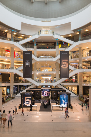 KUALA LUMPUR, MALAYSIA - 02 NOV 2014: Pavilion shopping mall, many fashion outlets in a modern light interior.