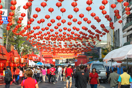 dozens: BANGKOK, THAILAND - 8 FEB 2016: Dozens of Chinese Paper Lanterns Suspended over a Street in Chinatown