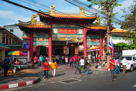 beneficence: BANGKOK, THAILAND - 8 FEB 2016: Traditional Chinese Architectural Arch at charity Thian Fan Foundation Shrine temple in Chinatown.