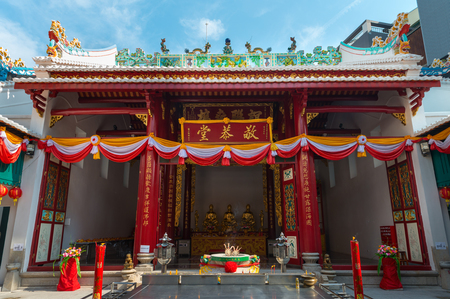 guangdong: BANGKOK, THAILAND - 8 FEB 2016: Guangdong shrine or Canton temple with red columns Golden Statues at a Religious Altar.