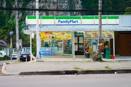 family mart: KRABI, THAILAND - 13 OCT 2014: Ao Nang Family Mart twenty-four-hour convenience store with many ATM machines.