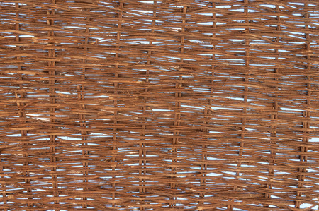 sun screen: Sunlight peaks through the handmade, profusely woven, natural fibers of a screen made for protection from the tropical sun. Background. Stock Photo