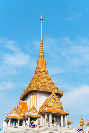spire: Ornate and intricately detailed roof and spire of Wat Traimit, a temple and home to the worlds largest golden Buddha statue. Stock Photo