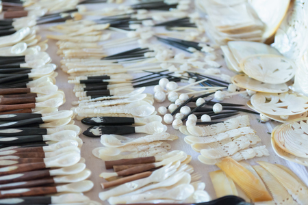 mother of pearl: Mother of pearl shell hand made spoons and grooming tools on table souvenir display from Inle Lake Burma