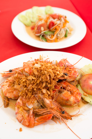fried shrimp: Delicious healthy Thai food cuisine fresh exotic fried shrimp delicacy served on a white plate with salad in white bowl Stock Photo