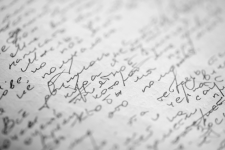 visible: Hastily scrawled handwriting of cyrillic text using black ink on white paper, with visible imprints from writing on the obverse.