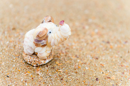 souvenir traditional: Traditional  decorative hand made small animal souvenir made from sea shells at beach sand