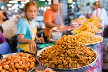 phuket food: PHUKET, THAILAND - 9 APR 2016: Thai food stall with spice fruits on weekend night market in Phuket town. Editorial