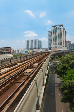 BANGKOK, THAILAND - 07 MAY 2014: BTS metro Skytrain line pass through the city centre above cars at roads. BTS or the Skytrain is an elevated rapid transport system in Bangkok, Thailand. Editorial