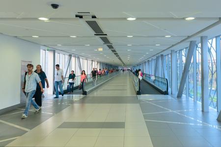 controlled: DUBAI, UAE - 16 JULY 2014: Climate controlled pedestrian bridge between Dubai Mall and the Metro station.