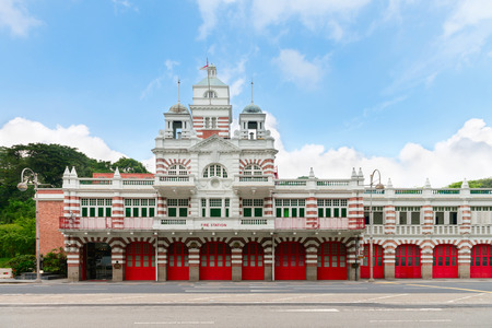 Vintage retro fire station building with red gates and brick walls Editorial