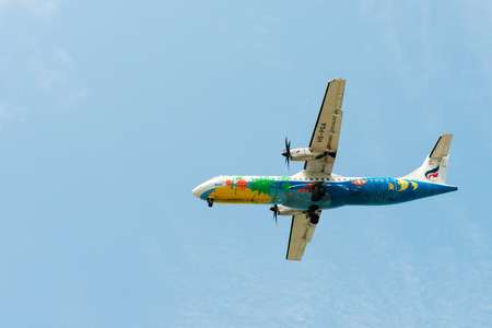 SAMUI, THAILAND - 04 MAR 2013: Flying Bangkok Airlines propeller-driven airplane in clean blue sky Editorial
