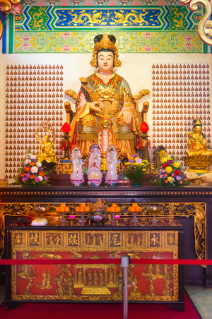 KUALA LUMPUR, MALAYSIA- FEB 2015: Shui Wei Sheng Niang goddess statue and altar in the chinese Thean Hou temple. Editorial