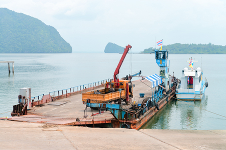 Ferry boat vessel for passengers and cars to islands in Thailand is parked for maintenance.