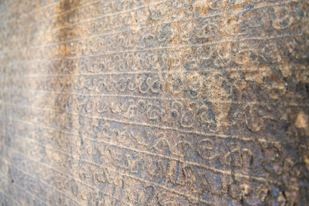 Sinhala inscription on the flat stone surface with shallow depth of fields