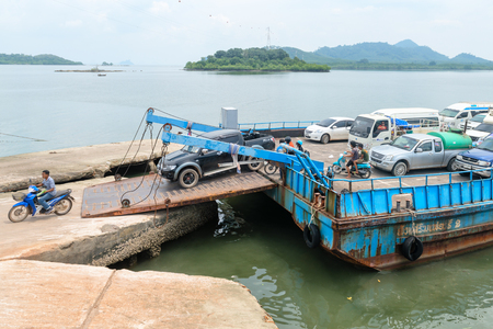LANTA, KRABI, THAILAND - 17 OCT 2014: Debarkation of ferry boat vessel for passengers and cars from mainland to Koh Lanta Noi island.