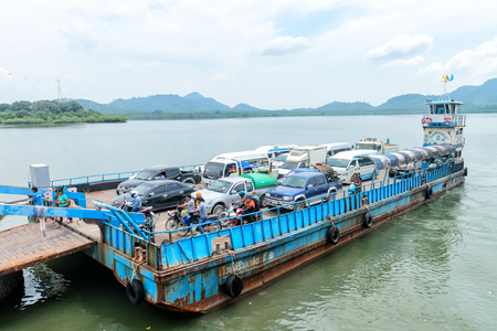 LANTA, KRABI, THAILAND - 17 OCT 2014: Ferry boat vessel for passengers and cars from mainland to Koh Lanta Noi island is landing to jetty.