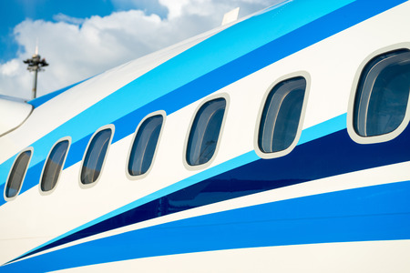 Airplane windows in passenger aircraft with outside view Фото со стока
