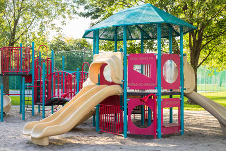 Children playground in the public park in summer without people