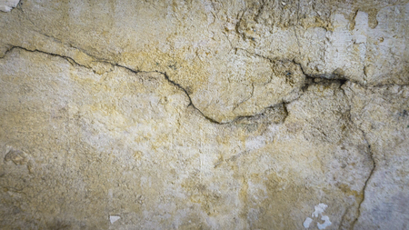 Cement crack wall texture background. Cracked wall Imagens