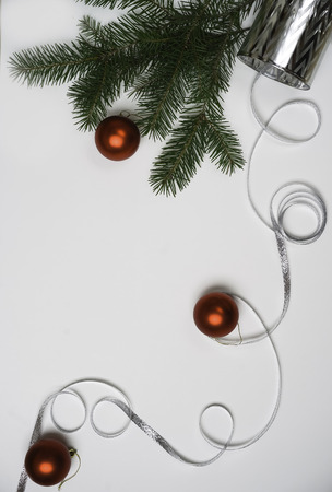 Flat lay Marry Christmas and Happy New Year decoration concepts for greeting card for party: red balls silver ribbon and fir tree. Close-up, copy space Stock Photo