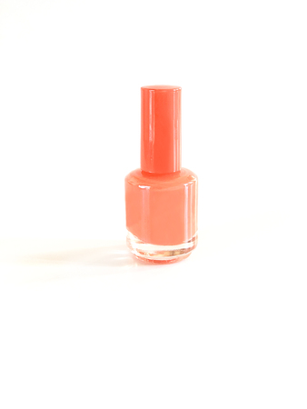 Trend of the actual colors for season 2019 - Living Coral. Isolated nail bottle on a white background with a place for the inscription, close up, copy space 写真素材