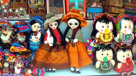 Peruvian dolls sale in souvenir shop of Cusco, Peru. Handmade. Close up souvenirs of Peru, in a traditional market. Selective focus