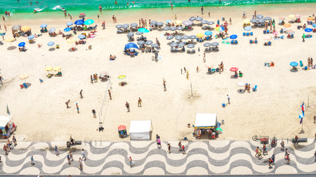 Rio de Janeiro, Brazil - 01.01.2019 Copacabana beach in Rio de Janeiro, Brazil. Aerial view of famous Copacabana sandy Beach with turquoise water and sidewalk mosaic with palms. Top view, horizontal Editorial