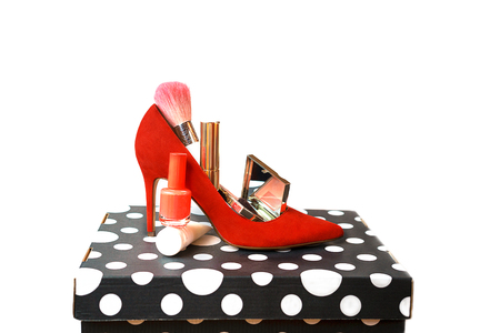Trendy outfit layout red shoes accessories makeup cosmetics on black and white box and white