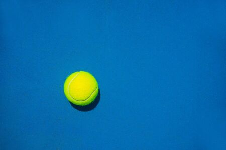 Tennis ball on blue