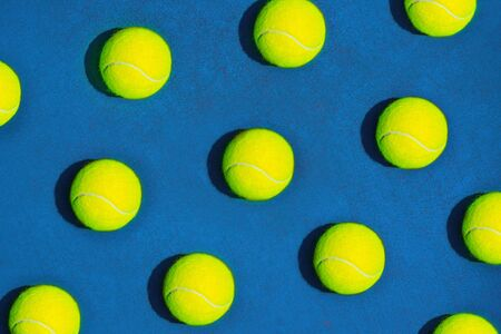 Creative composition made with tennis ball on blue