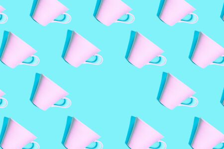 Coffee pattern of pink cup for coffee on bright blue