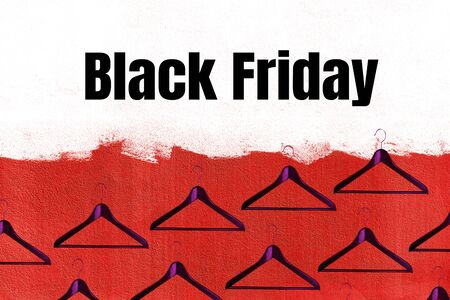 Black Friday sale concept with fashion clothes hanger pattern on red and white color wall background. Shopping. Outfit. Flat lay, top view.