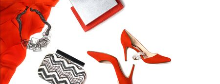 Top view outfit layout: red shoes, accessories jewelry, clutch, gift box on white