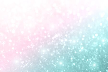 Christmas New Year colorful defocused pastel background with snowflakes and blinking stars. Holiday party blurred bokeh, bright lights. Winter concept.