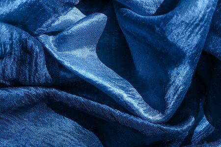Blue color 2020 inscription. Blue silk textures. Gift concept.