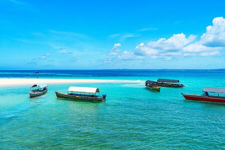 Panoramic view of a beautiful sunny day on sandy beach and fishing boats in the Zanzibar. Tropical travel concept. Reklamní fotografie