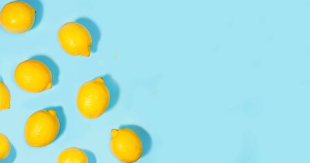 Creative layout made of lemon on green mint color background. Flat lay. Food summer concept.
