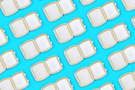 Pattern made of food delivery package or lunch box on pastel blue color background. Catering. Delivery Service in coronavirus epidemic.