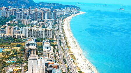 Rios Best Beaches with turquoise water: famous Copacabana Beach, Ipanema Beach, Barra da Tijuca Beach in Rio de Janeiro, Brazil. Aerial view of Rio de Janeiro from helicopter. Top view, horizontal