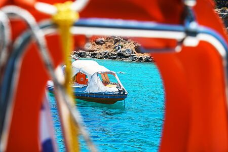 Composition with lifebuoy ring. Sailing yacht catamaran boat on turquoise waters of Aegean Sea near Athens. Yachting. Famous travel sailing destination in Europe. Sailboat.