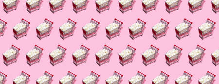Shopping trolley pattern on pastel pink background. Shopping Cart as sign of Black Friday.