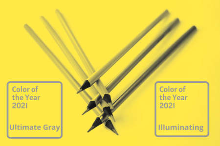 Abstract bright illuminating yellow and gray colours background with pencils. Trendy colors of the year 2021 - Gray and Yellow.