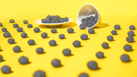 Blueberries are scattered on the table in Illuminating yellow and gray colours background. Concept of Color of the Year 2021.