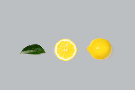 Creative layout made of bright illuminating yellow lemons on gray color background. Concept of Color of the Year 2021. Flat lay, close up.