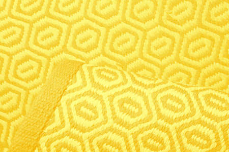 Bright IlluminatingYellow and Gray Wool Rug Carpet Texture Background. Concept of Color of the Year 2021 with bright illuminating yellow and gray colours. Top view, flat lay, copy space.