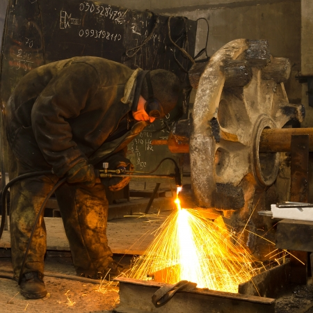 Sparks and drops of molten metal during work of welder