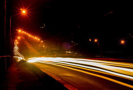 Lights of cars on the road the night city